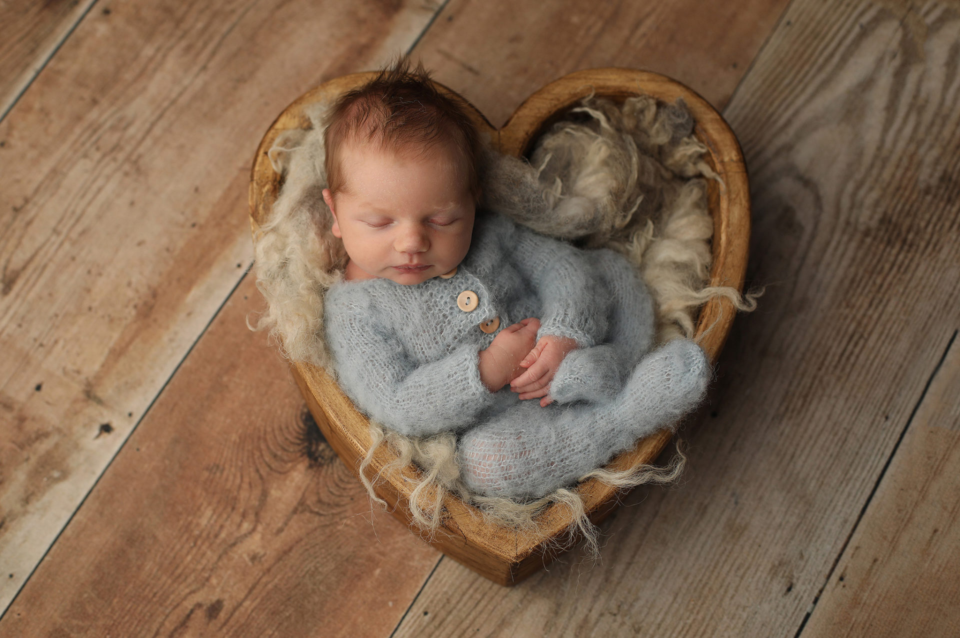 Newborn Baby poses in bowl