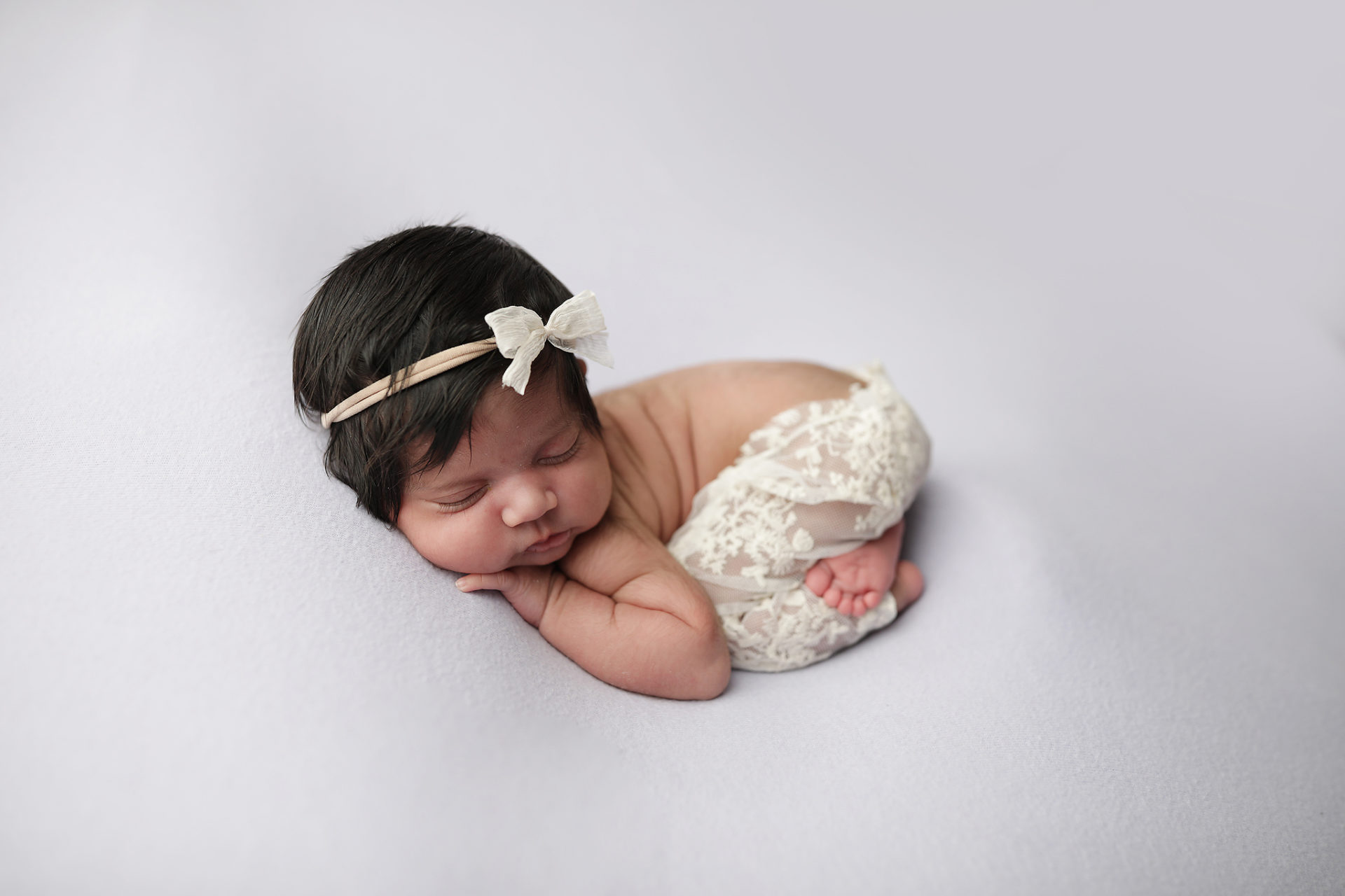 Tucson Newborn poses for pictures
