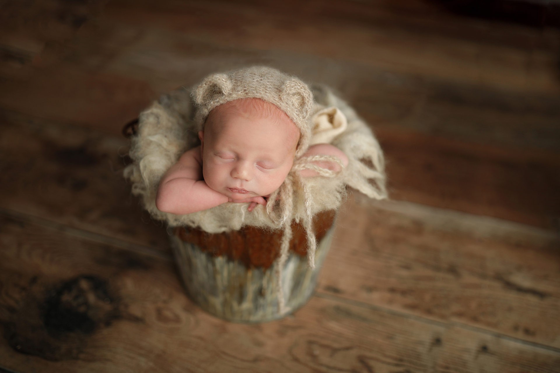 Newborn posing in a bucket