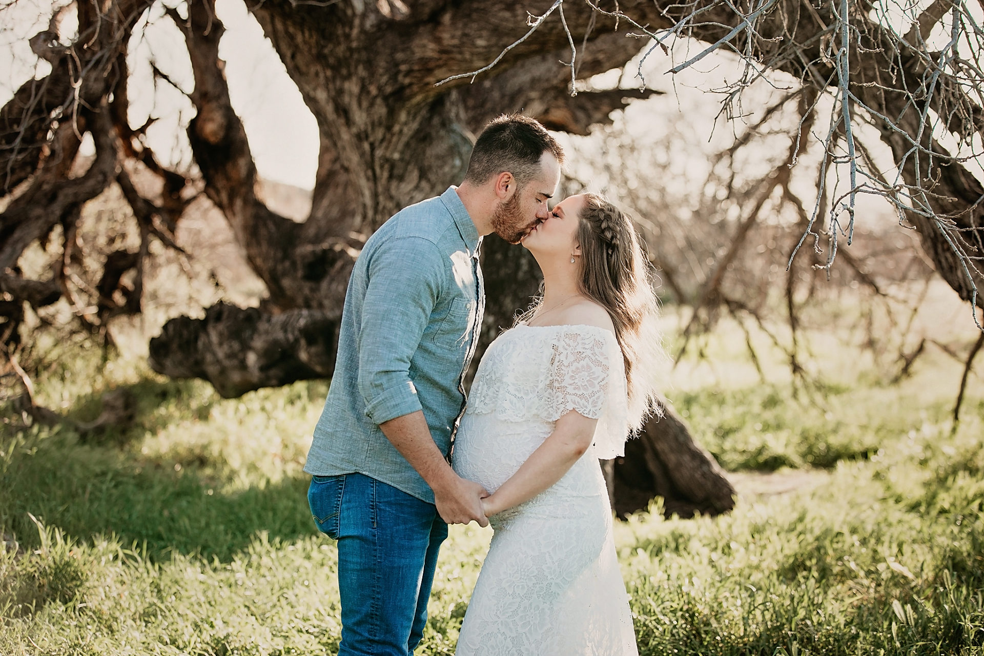 couple poses for pregnancy maternity pictures