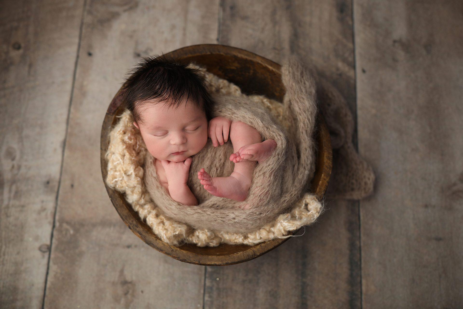 Tucson baby poses in bucket